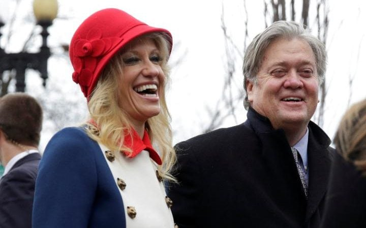 Advisors to President-elect Donald Trump, Kellyanne Conway and Steve Bannon depart from services at St. John's Church during the Presidential Inauguration in Washington. Conway is wearing a bizarre outfit reminiscent of the American Revolution, featuring a red cloche hat and a blue-and-white double-breasted coat with two long rows of large buttons and a bright red collar