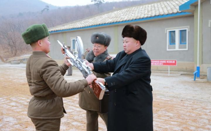 North Korean leader Kim Jong Un takes a weapon from a ramrod-upright soldier as he inspects a sub-unit under KPA Unit 233, in this undated photo released by North Korea's Korean Central News Agency (KCNA) in Pyongyang January 19, 2017