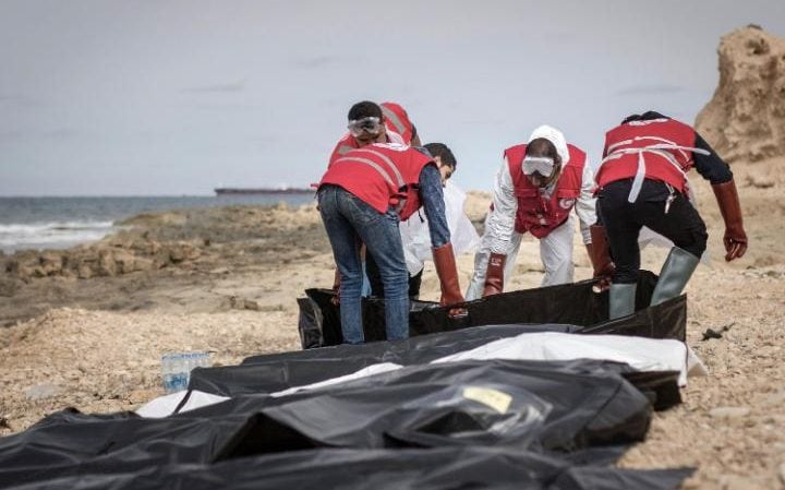 The Al-Zawiyah Branch of the Libyan Red Crescent shows Libyan Red Crescent volunteers recovering the bodies of 74 migrants that washed ashore on February 2