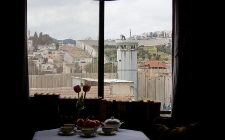An Israeli security watch tower is seen from one of the rooms