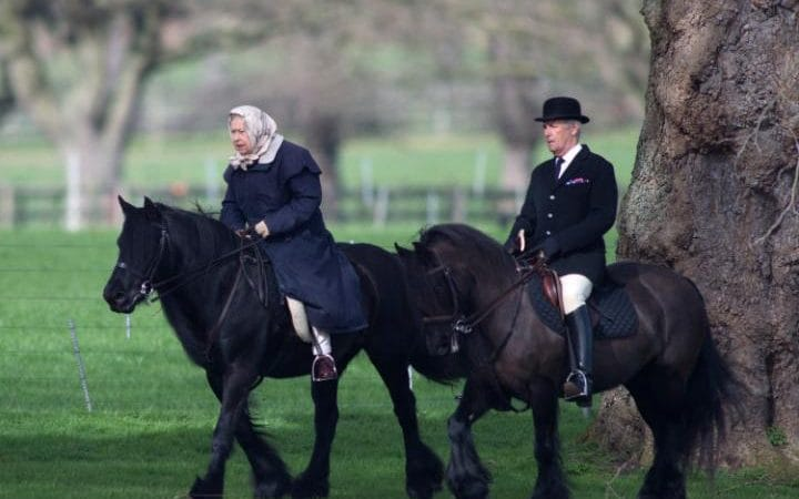 HM The Queen accompanied by her Head Groom Terry Pendry Rides along rides along the Riverbank at Windsor castle