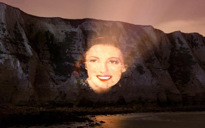 The  Forces  Sweetheart  projected onto the iconic White Cliffs of Dover