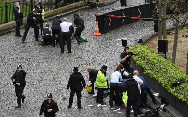 Police officer being treated for stab wounds at the scene