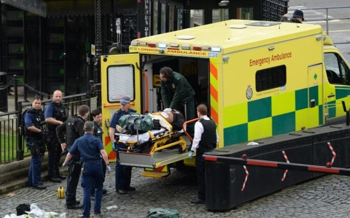 Paramedics attend to alleged attacker Khalid Masood outside the Palace of Westminster