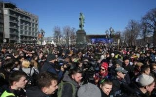 People take part in an unsanctioned rally in Moscow on March 26