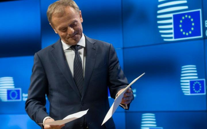 European Council president Donald Tusk holds the letter giving Britain's official notice under Article 50