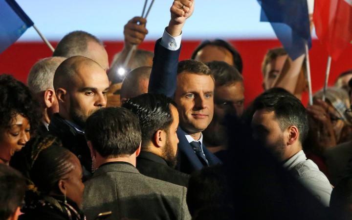 Emmanuel Macron is surrounded by supporters as he celebrates at a rally in Marseille, Southern France, April 1