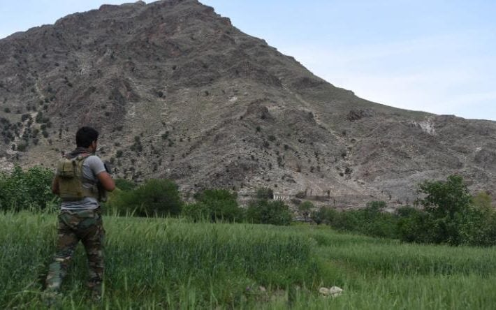 Afghan soldier patrols the area where US forces dropped GBU-43 bomb for the first time against caves used by Islamic State