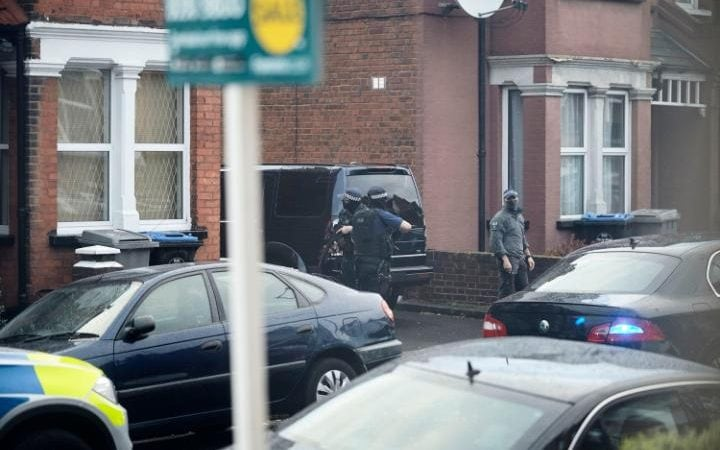 Police outside the terraced house in Willesden