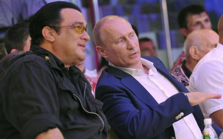 Vladimir Putin speaks with Steven Seagal during the Mixed fight Championship in the Russian Black Sea resort of Sochi in 2012