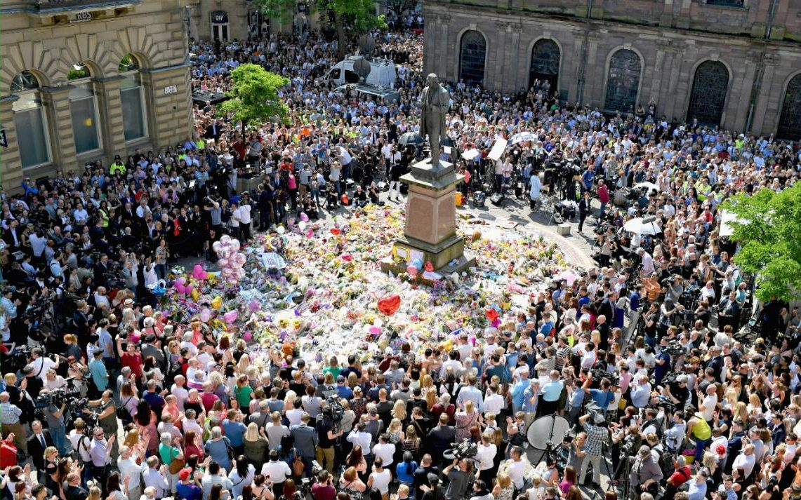 Members of the public observe a national minute's silence in remembrance of all those who lost their lives in the Manchester Arena attack, in Manchester, England. An explosion occurred at Manchester Arena on the evening of May 22 as concert goers were leaving the venue after Ariana Grande had performed. Greater Manchester Police are treating the explosion as a terrorist attack and have confirmed 22 fatalities and 59 injured.
