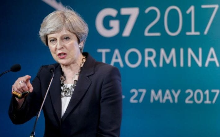 British Prime Minister Theresa May speaks during a news conference in the Sicilian town of Taormina, Italy
