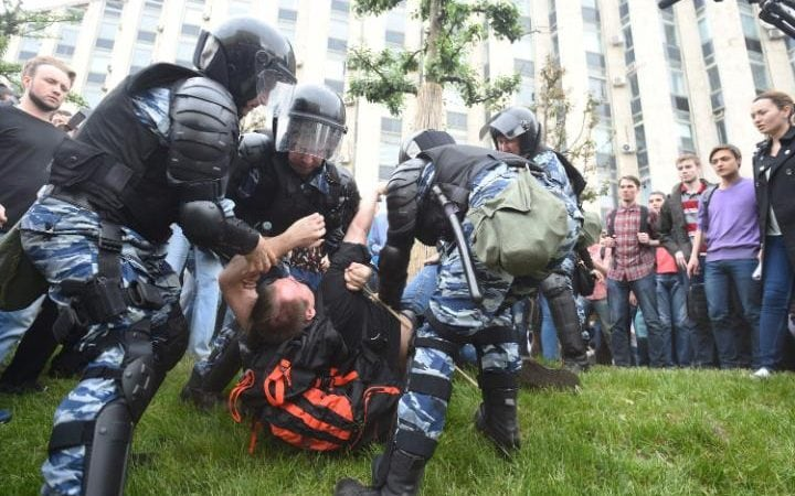 Russian police officers detain a participant of the opposition rally in Tverskaya street, central Moscow