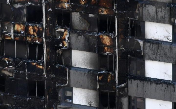 White cladding pictured on the right of Grenfell Tower