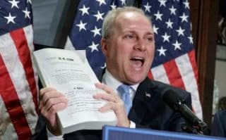 Republican Phil Roe holds up a copy of the original Affordable Care Act bill.