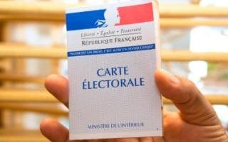 A electoral card from the second round of the French legislative elections at a polling station in Pointe-a-Pitre.