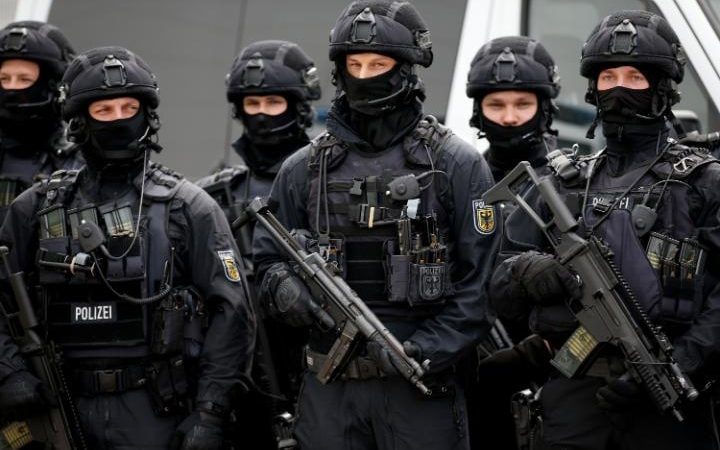 A special federal police unit stands during a visit by German Interior Minister Thomas de Maiziere
