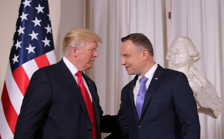 U.S. President Donald Trump is greeted by Polish President Andrzej Duda
