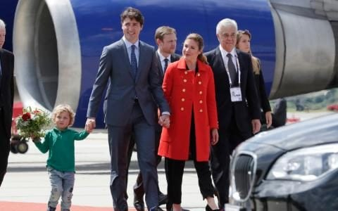Canada's Prime Minister Justin Trudeau, center, holds the hands of his son Hadrien, left, his wife Sophie Gregoire-Trudeau as they arrive for the G-20 summit in Hamburg