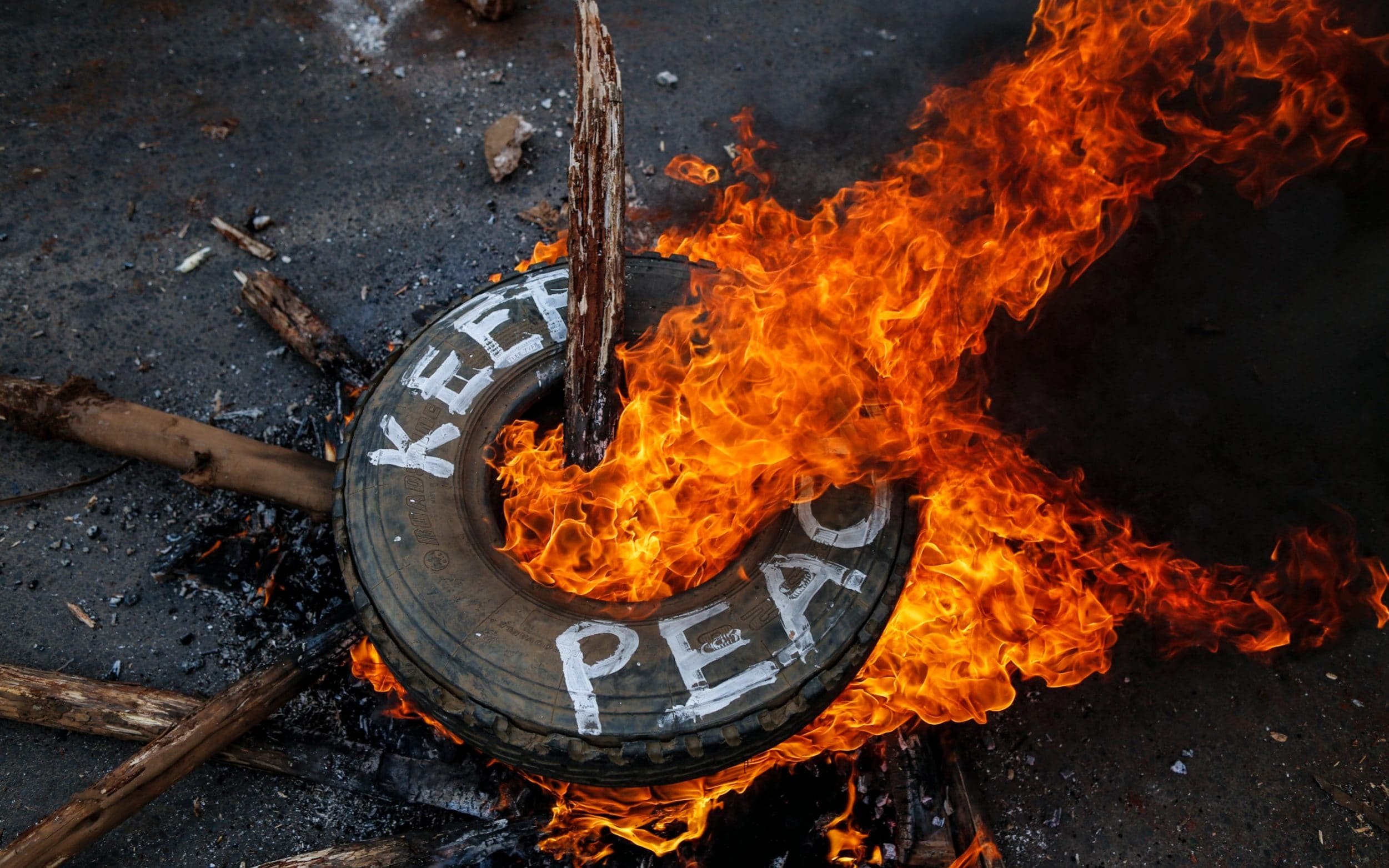 Supporters of the opposition leader Raila Odinga burn a tyre