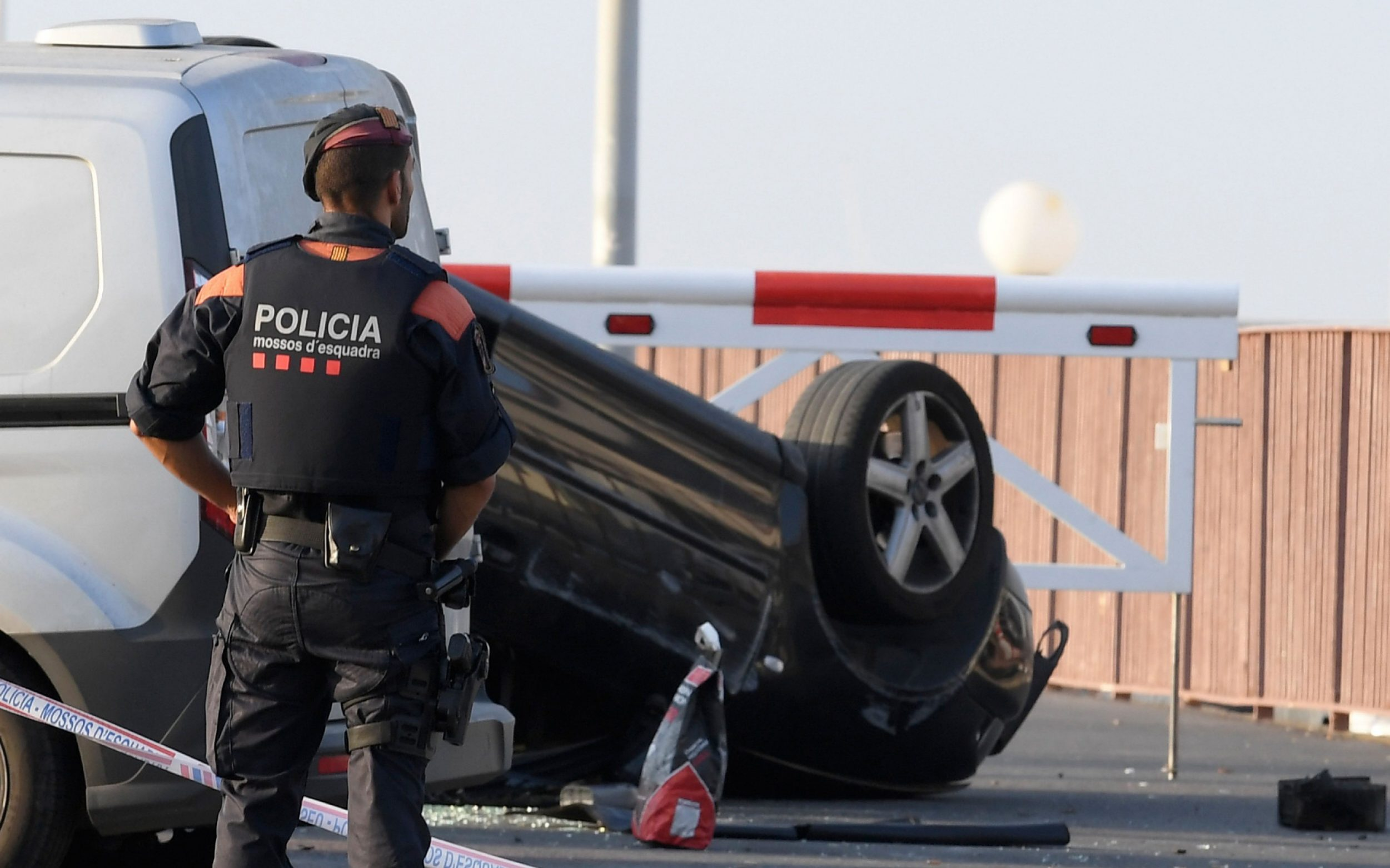 A policeman stands by a car involved in a terrorist attack in Cambrils, a city 120 kilometres south of Barcelona