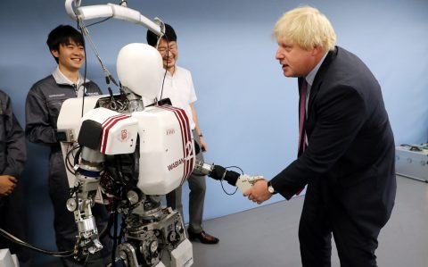 Britain's Foreign Secretary Boris Johnson shakes hands with a humanoid robot Wabian2 at at Waseda University in Tokyo, earlier this year