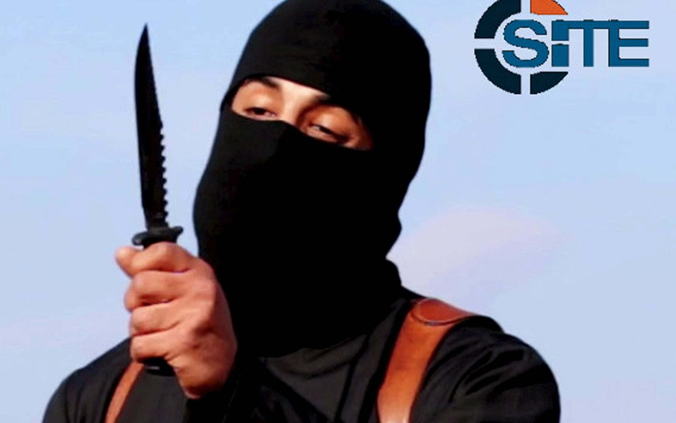 A masked, black-clad militant, who has been identified by the Washington Post newspaper as a Briton named Mohammed Emwazi, brandishes a knife in this still file image from a 2014 video obtained from SITE Intel Group February 26, 2015