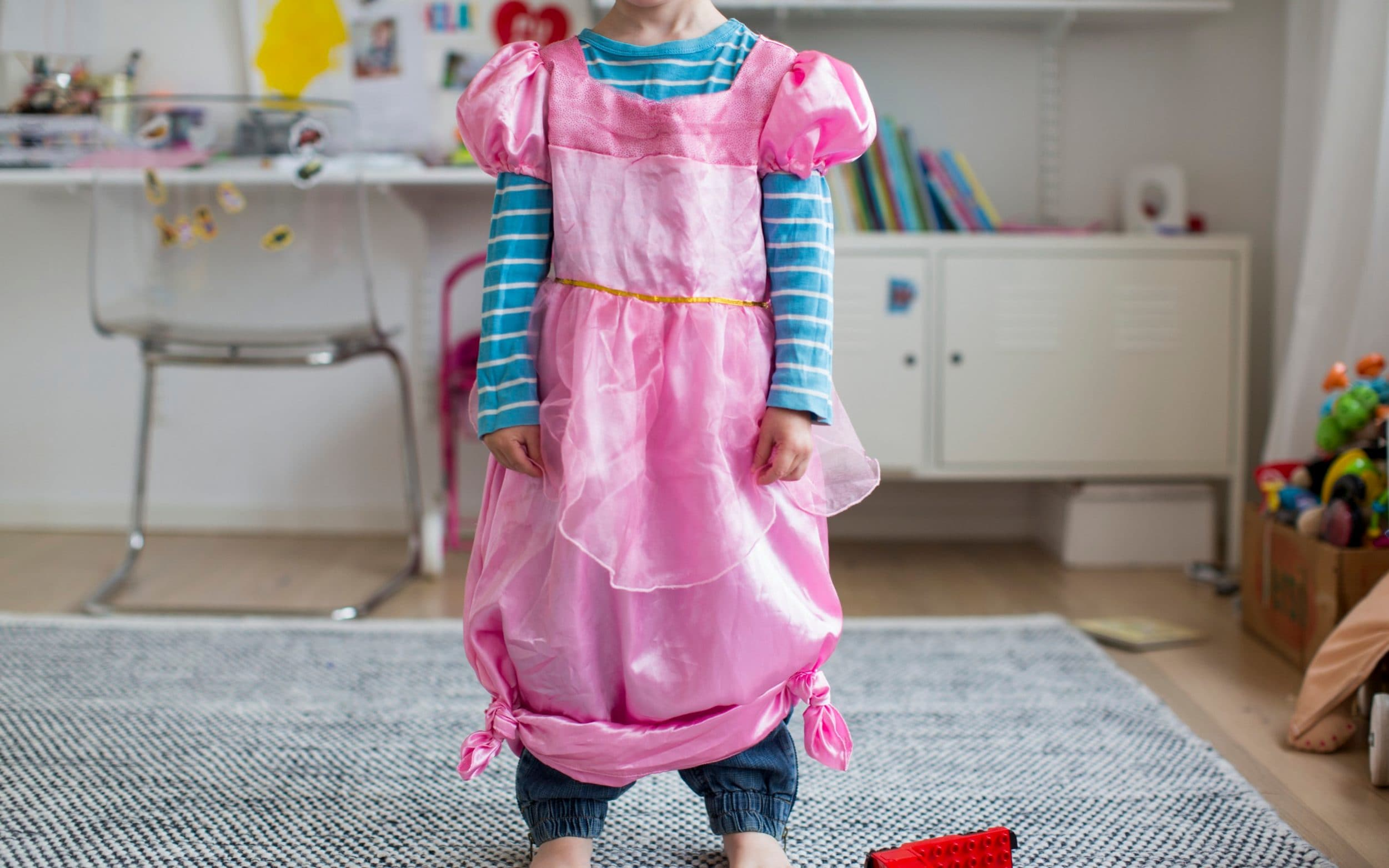 Child wearing fancy pink dress