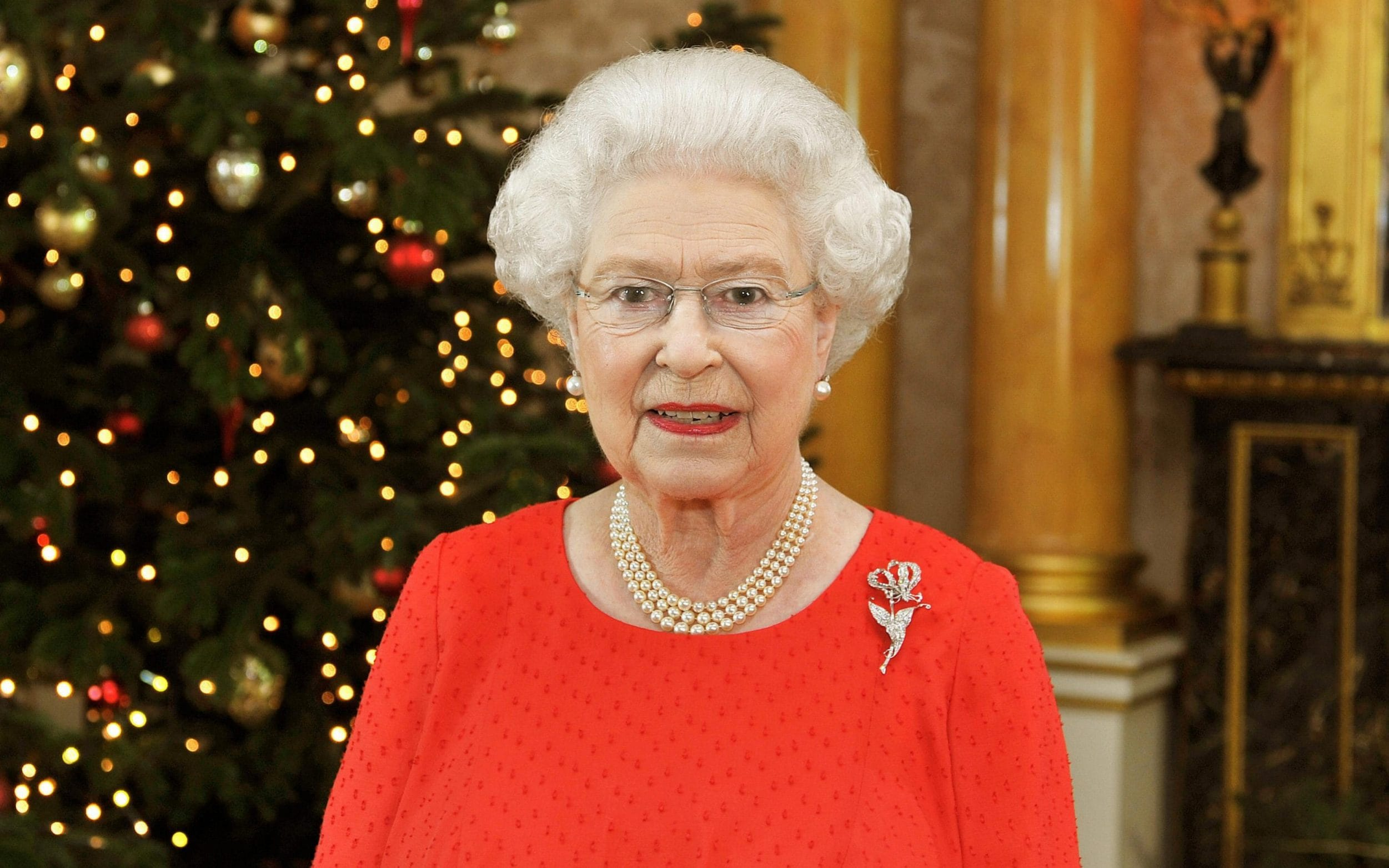 Her Majesty stands in the 1844 Room of Buckingham Palace in London, after recording her Christmas Day television broadcast to the Commonwealth in 2011