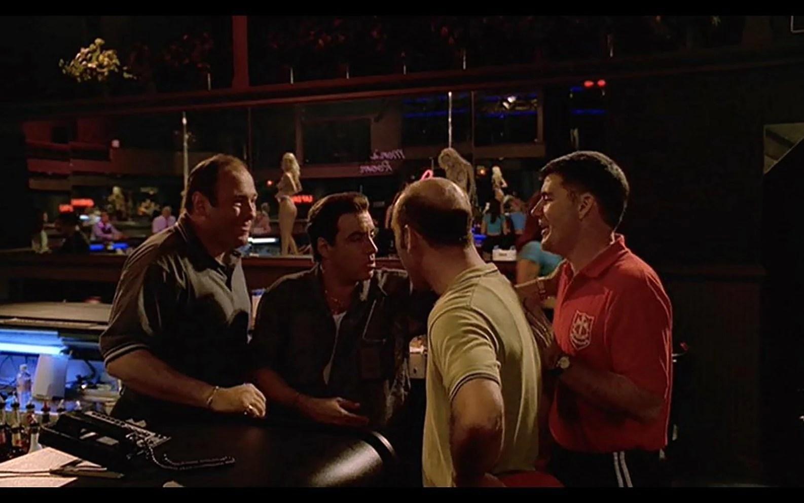 James Gandolfini (far left) as Tony Soprano in the fictional Bada Bing club