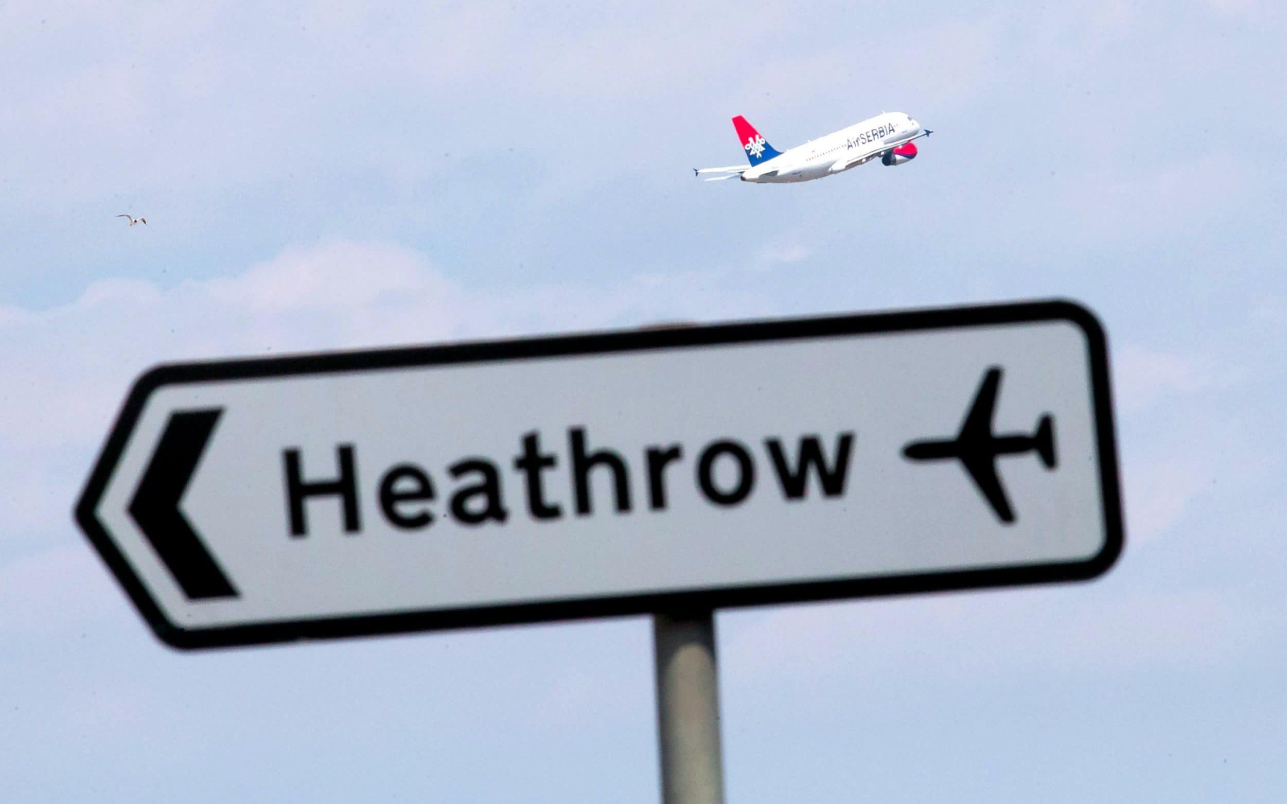 A plane taking off at Heathrow Airport,