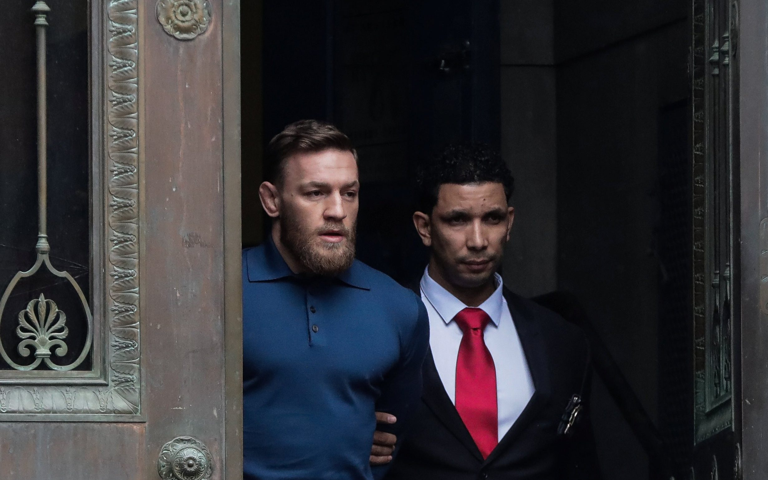 stunning steel chair attacks desk leather huge brawl breaks out after khabib nurmagomedov conor mcgregor walks of new york s 78th police precinct being charged with attacking a bus