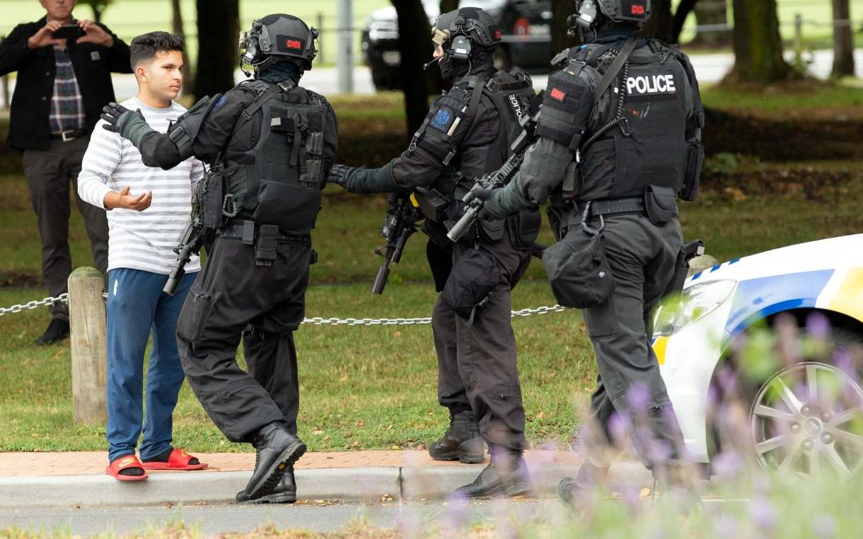 Armed police push back members of the public following a shooting at the Masjid Al Noor mosque in Christchurch, New Zealand