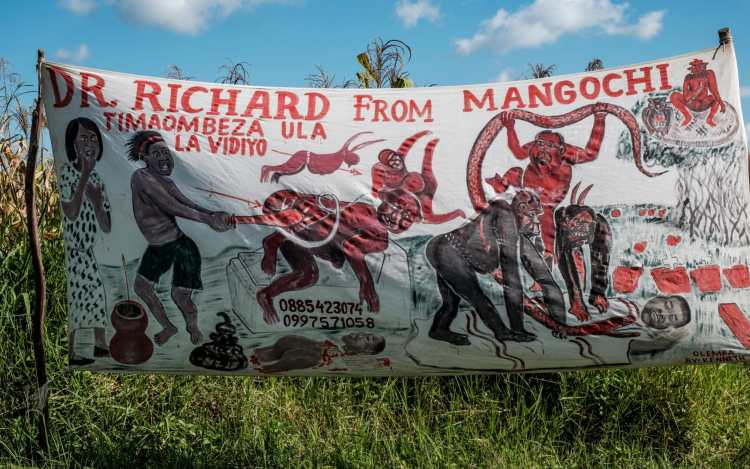 A typical banner promoting a witch doctor on the route to Mulange CREDIT: EDUARDO SOTERAS JALIL