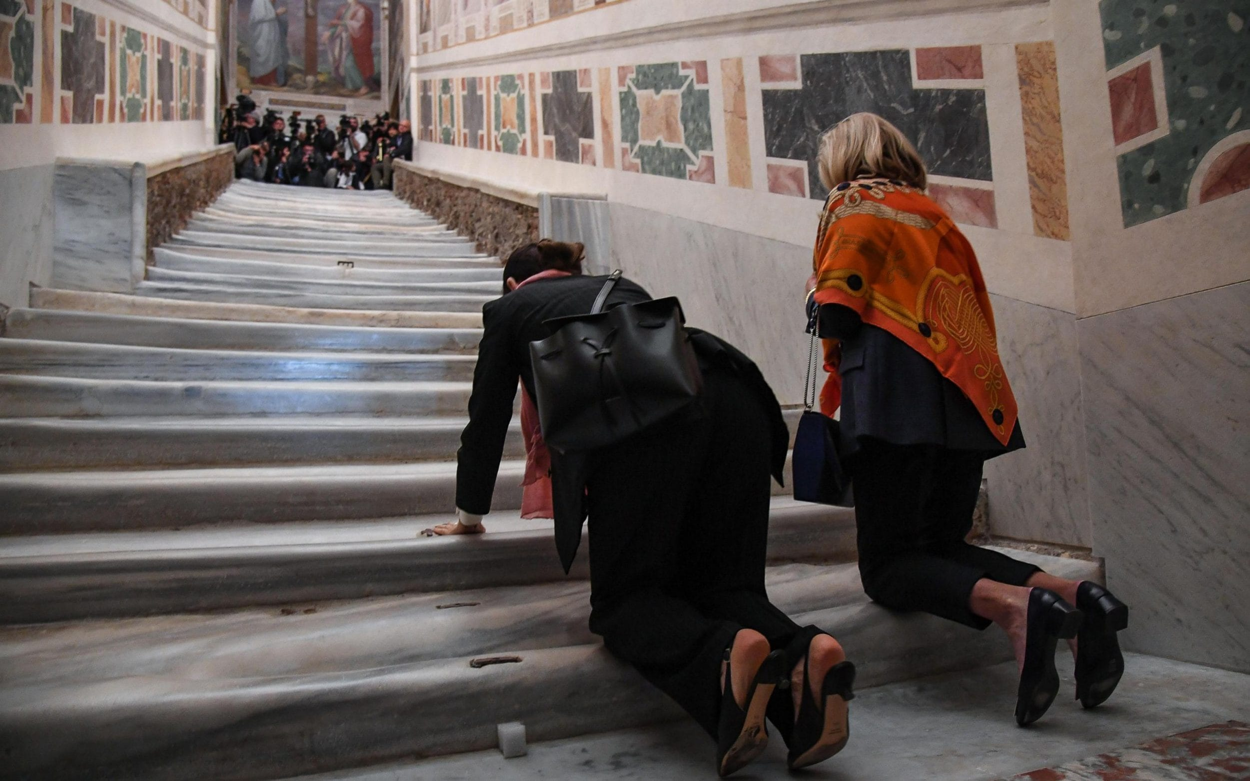 Catholic devotees climbed the newly restored staircase on their knees in a traditional act of penitence and devotion
