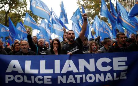 """French police officers attend the """"March of Anger"""" to protest against poor working conditions in Paris"""