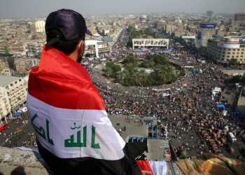 Thousands of protesters burn tyres and block roads in Baghdad protest