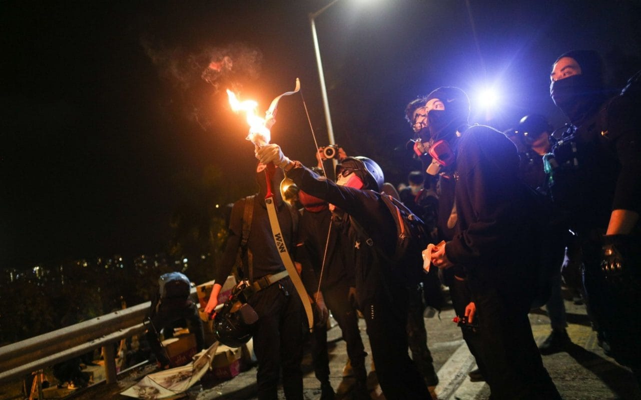 Hong Kong protesters launch fire-dipped arrows at police in latest university clashes