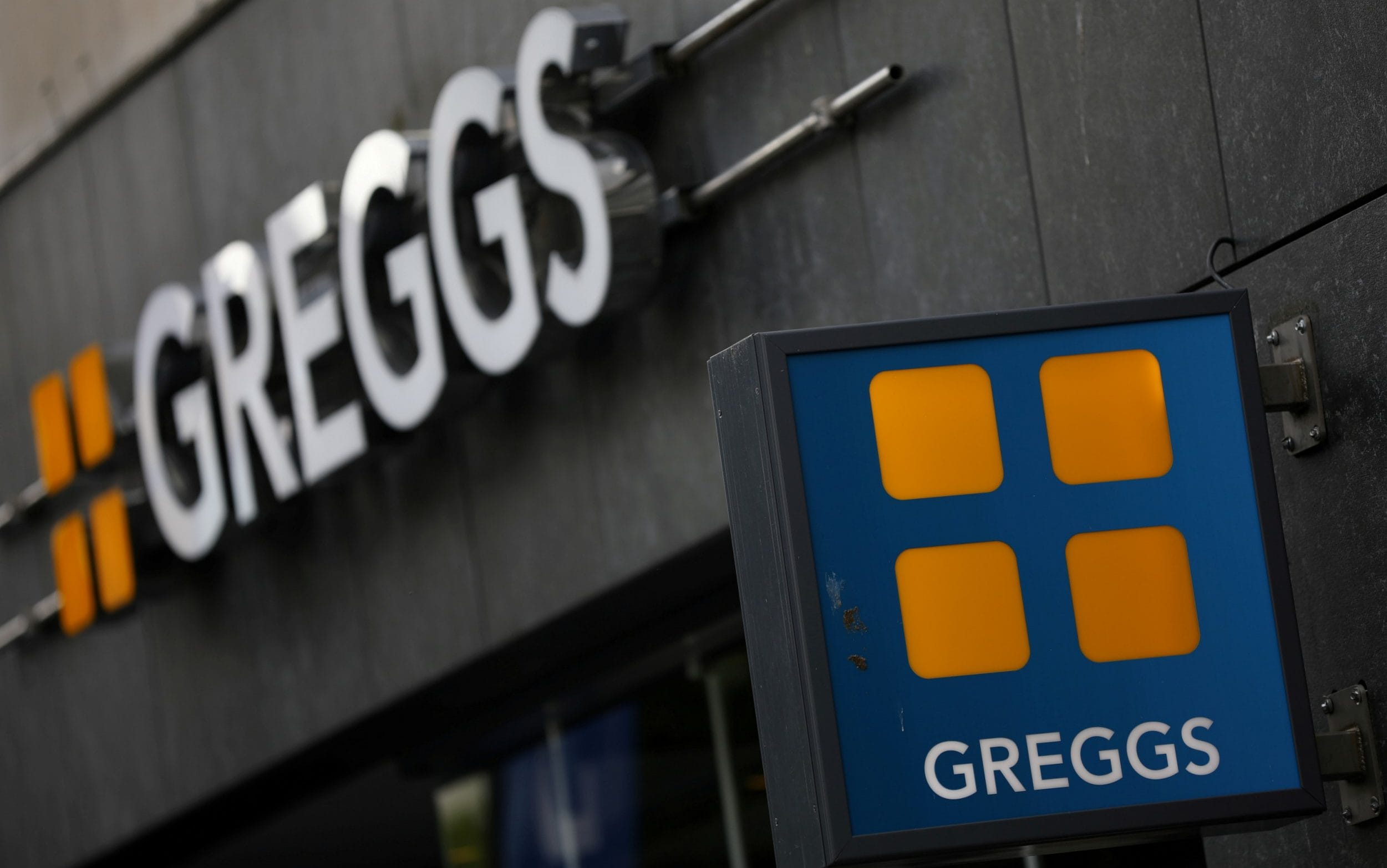 A Greggs sign and logo