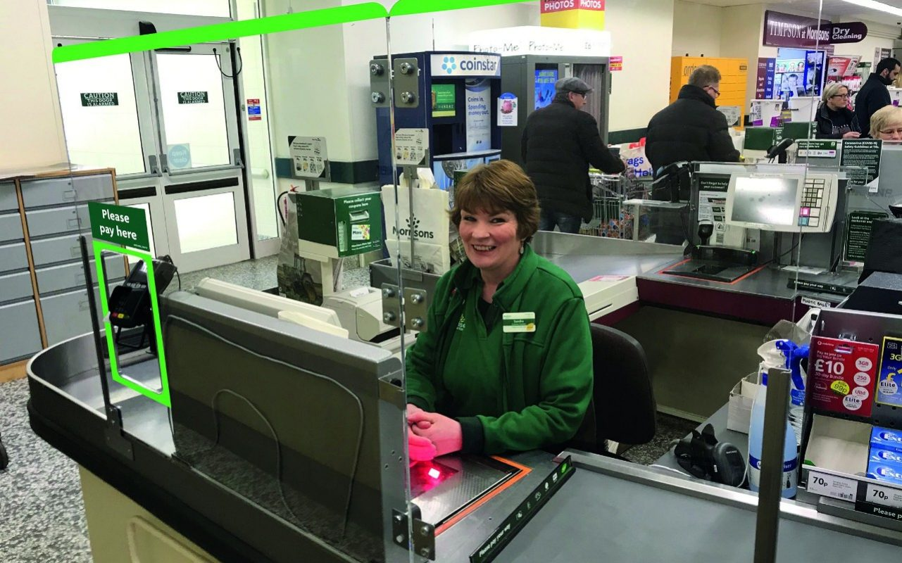 Supermarkets take action to ensure social distancing as staff prepare for plastic barriers between them and customers
