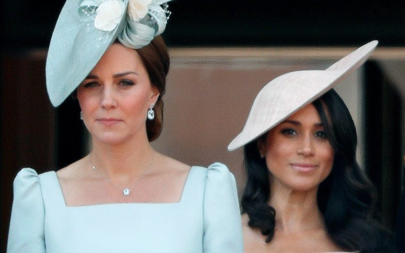 Catherine, Duchess of Cambridge and Meghan, Duchess of Sussex stand on the balcony of Buckingham Palace