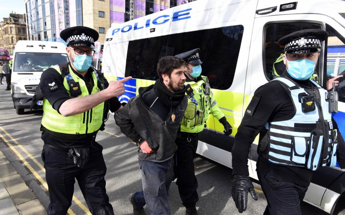 West Yorkshire lead a protester away from the demonstrations