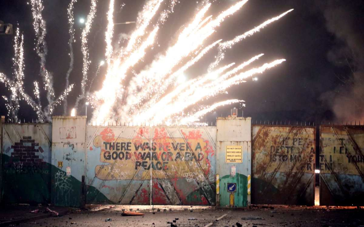 Fireworks explode at the peace wall on Lanark Way in west Belfast