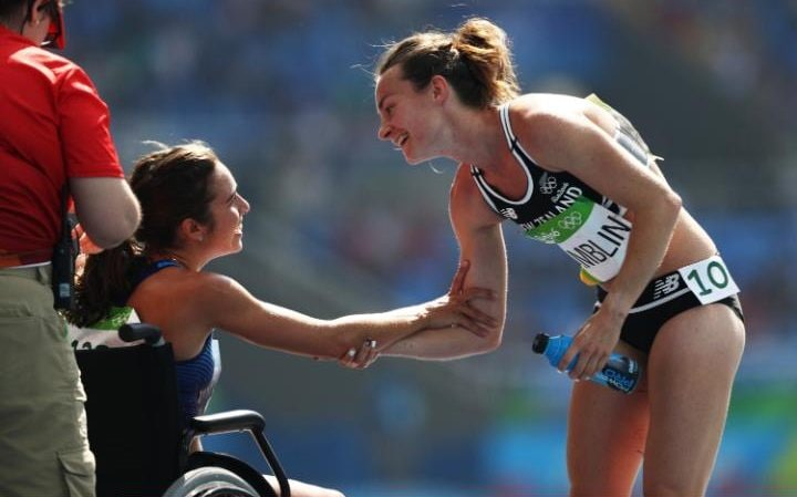 Abbey D'Agostino of the United States (L) talks with Nikki Hamblin of New Zealand after the Women's 5000m Round 1 - Heat 2 on Day 11 of the Rio 2016 Olympic Games at the Olympic Stadium on August 16, 2016