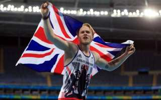 Jonnie Peacock celebrates winning Gold during the Men's 100m - T44 final.