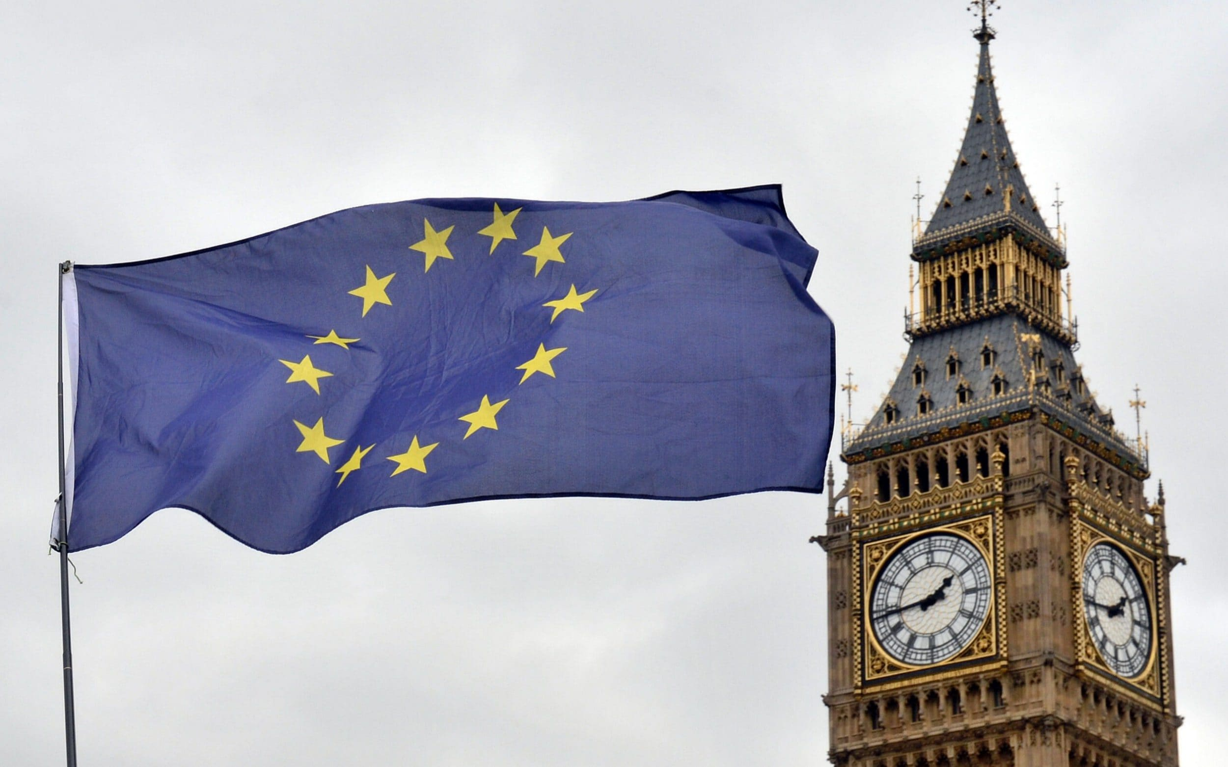 A European Union flag in front of the Elizabeth Tower