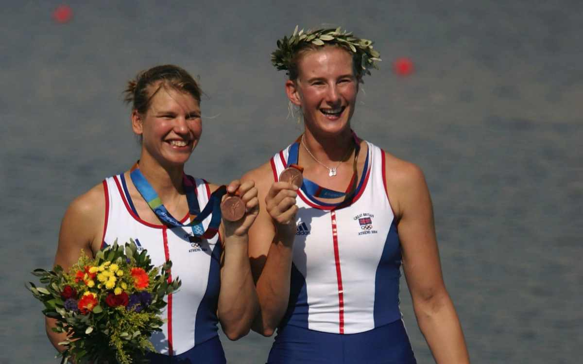 Sarah Winckless (L) and Elise Laverick of Great Britain stand on the podium after claiming bronze in the women's double sculls at Athens 2004