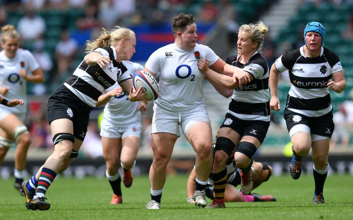 Hannah Botterman of England makes a break past Tamara Taylor and Claire Molloy of Barbarians during the England Women v Barbarian Women match at Twickenham