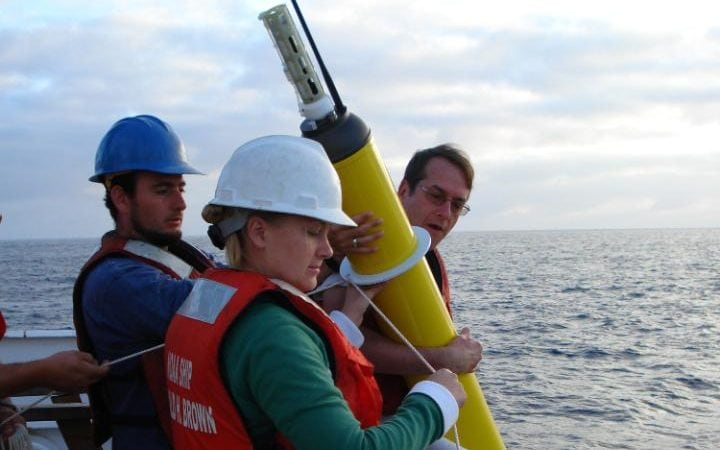 This NOAA Corps photo shows the deploying an Argo float to capture ocean temperature data