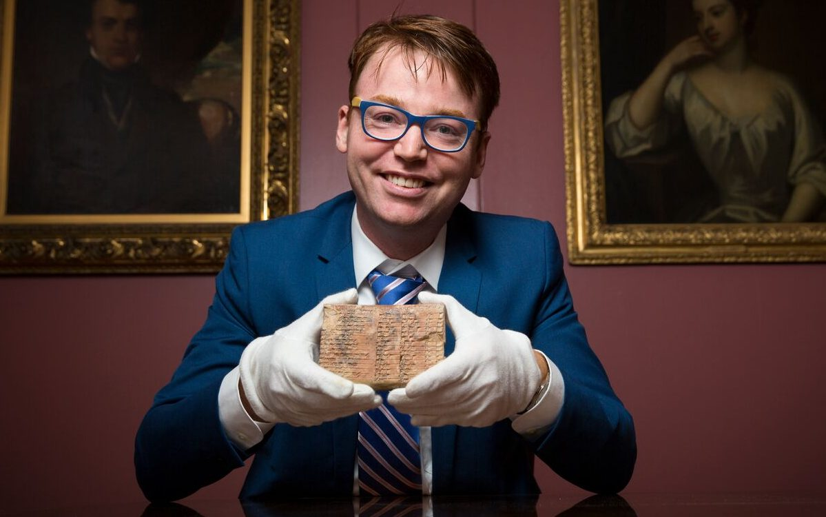 Dr Daniel Mansfield with the 3,700-year-old trigonometric table